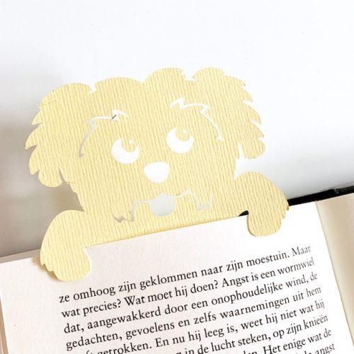dit hondje wijst je waar je bent gebleven in je boek